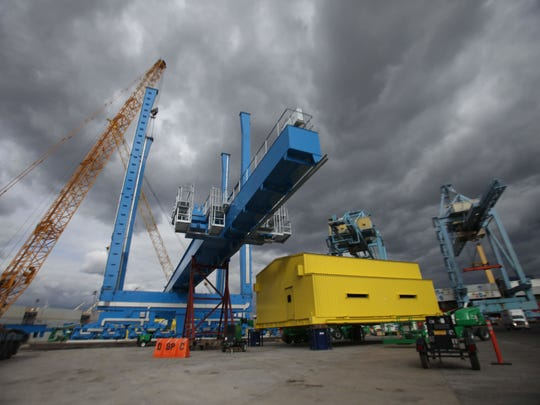 One of two new gantry cranes at the Port of Wilmington is being assembled on the banks of the Christina River. One of two new gantry cranes at the Port of Wilmington is being assembled on the banks of the Christina River.
