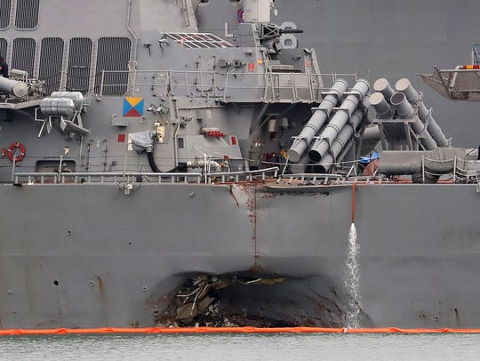 The damaged port aft hull of the USS John S. McCain