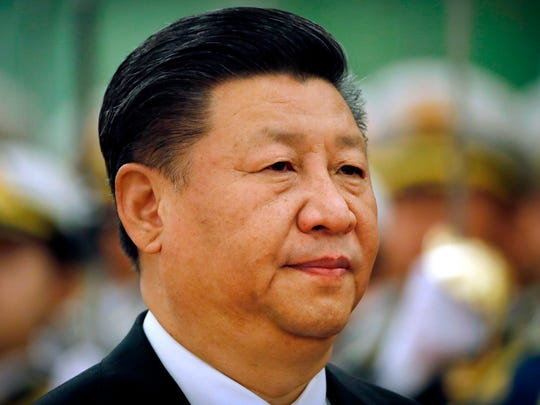 Chinese President Xi Jinping reviews an honor guard
