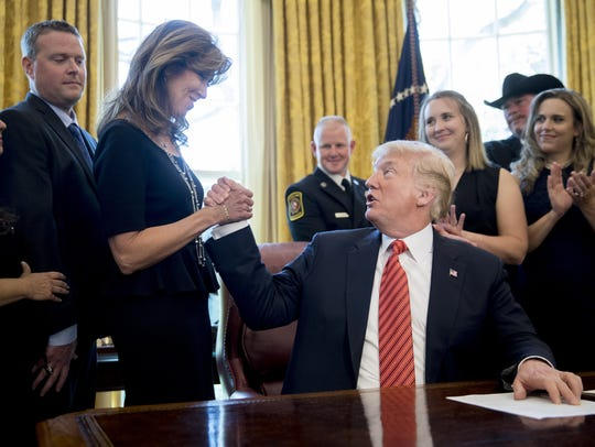 President Donald Trump, right, shakes hands May 1,