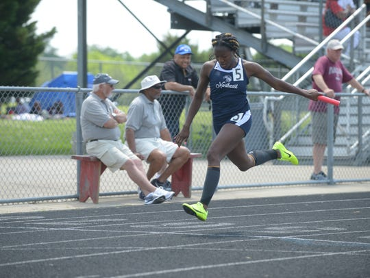 Northeast junior Calandra Henry finishes the 4x100