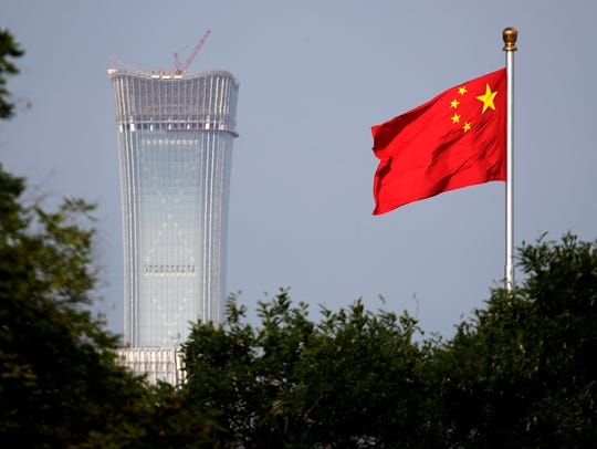 A Chinese national flag at Tiananmen Square flutters