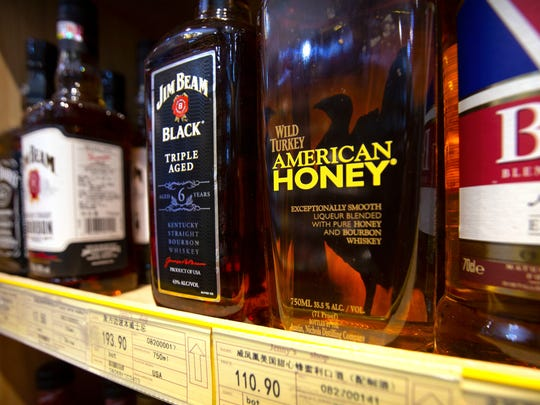 Whiskeys distilled and bottled in the U.S. are displayed for sale in a grocery store in Beijing on July 7, 2018.