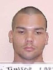 A 2005 mugshot of Junior Larry Hillbroom. In November 2005, Hillbroom pleaded guilty to one count of possession of methamphetamine as a third-degree felony in the Superior Court of Guam.