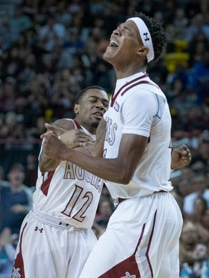 New Mexico State's Jemerrio Jones, right, was named Western Athletic Conference Player of the Year on Tuesday.