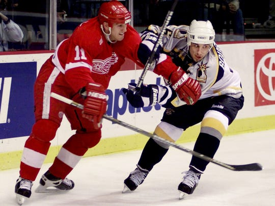 Detroit Red Wings' Mathieu Dandenault (11) fights Nashville