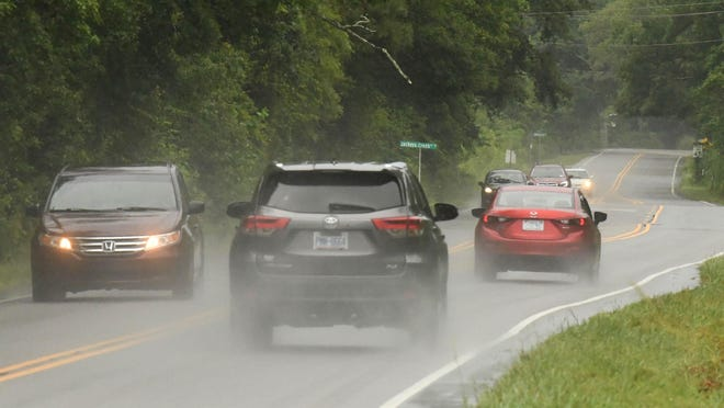 Cars travel down NC 133 in Leland on Tuesday as the rain falls from an incoming subtropical system. Heavy rains are expected throughout the rest of the day and Wednesday with some flooding in areas.