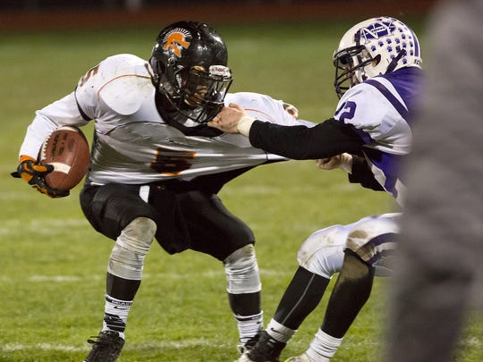 York Suburban's Dustin Knaub gets tackle for a Northern defender.  Northern York defeated York Suburban 30-16 in the first round of District III playoffs Friday, Nov. 13, 2015.