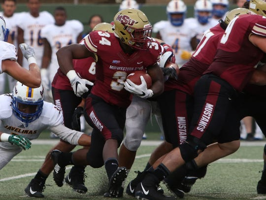 Midwestern State's Vincent Johnson runs past the line