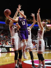Indianola junior Maggie McGraw gets a shot away. Seventh-seeded Indianola beat second-seeded Cedar Falls 64-63 in a Class 5A state quarterfinal at Wells Fargo Arena in Des Moines Feb. 26.