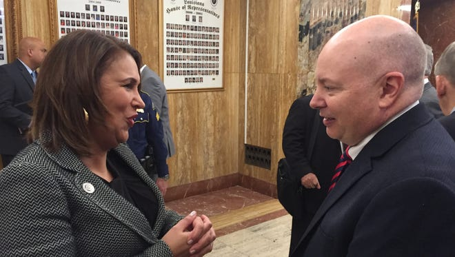 Ava Dejoie, executive director of the Louisiana Workforce Commission, speaks to Graphic Packaging executive Andy Johnson Monday in the Capitol after the company was recognized by Gov. John Bel Edwards for its investment in Ouachita Parish.