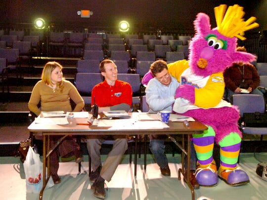 Adam Goins of Mount Ephraim, N.J., dressed as 'Reggy,' sits on the lap of judge Dave Raymond while auditioning to be the York Revolution's mascot  at DreamWrights Youth and Family Theatre in March 2007.