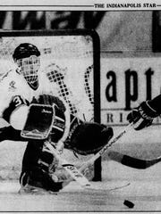 In this cutout from the Indianapolis Star on Jan 1, 1992, Ice goalie Dominik Hasek reaches out to deflect a shot by Milwaukee's Cam Brown.