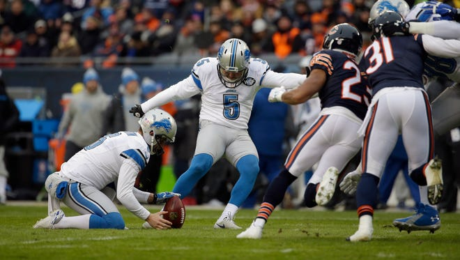 Detroit Lions kicker Matt Prater (5) kicks an extra point during the first half of an NFL football game against the Chicago Bears, Sunday, Jan. 3, 2016, in Chicago.