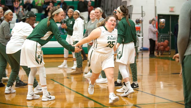 Kate Spadaro,  a senior at Camden Catholic High School with Downs syndrome, is introduced prior to Thursday's varsity girls basketball game between Camden Catholic and Lenape, played at Camden Catholic High School in Cherry Hill.  Spadaro, who has been a basketball player/manager and has been arguably the team's biggest supporter and cheerleader during her four years at Camden Catholic, was announced as one of the five starters for the game and scored a basket during the first quarter.