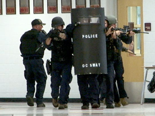 Ocean County SWAT team members proceed down a hallway