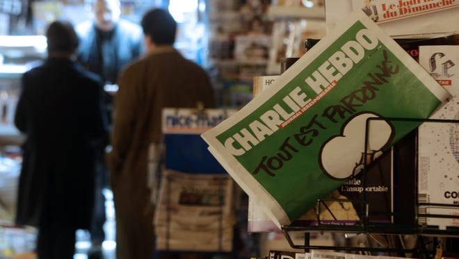 "A ""Charlie Hebdo"" newspaper is displayed at a newsstand in Nice southeastern France on Jan. 14."