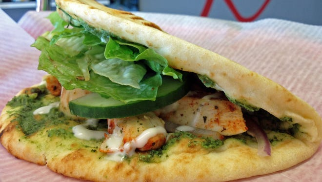 The Tandoori Chicken Naanwich from Happiness Healthy Cafe in Fort Myers