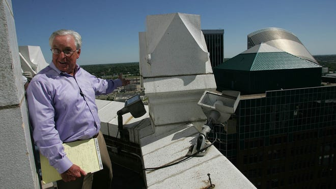 Bob Knapp in 2005 enjoys the view from on top of the Equitable Building in downtown Des Moines, where he began a renovation of the historic downtown building before being arrested on charges of asbestos violations in 2011.