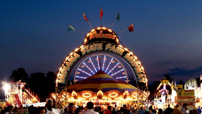 The Indiana State Fair midway lights up the final night of the 17-day event Aug. 17, 2014.