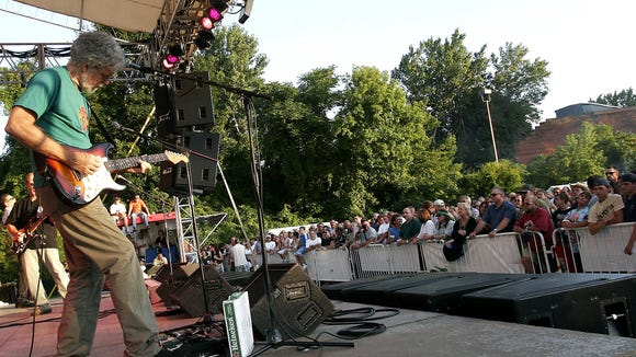 Little Feat guitarist Fred Tackett plays to an appreciative crowd at a packed Party in the Park on July 28, 2005.