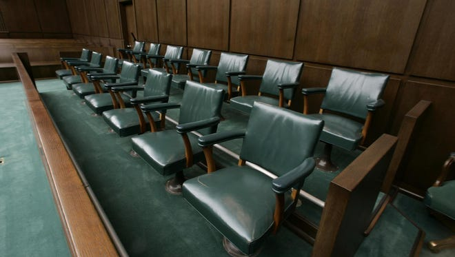 A jury box at the Robert Casey Federal Courthouse is shown in a file photo from Jan. 11, 2006, in Houston. (AP Photo/Brett Coomer, Pool, File)