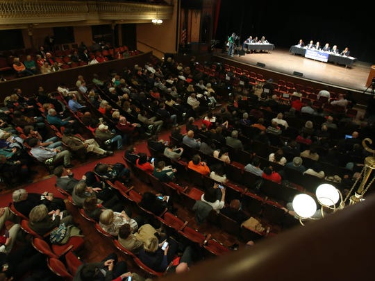 Wilmington mayoral candidates (from left) Theo Gregory, Norm Griffiths, Kevin Kelley, Bob Marshall, Mike Purzycki and Eugene Young take part in a debate Tuesday at the Grand Opera House in Wilmington.
