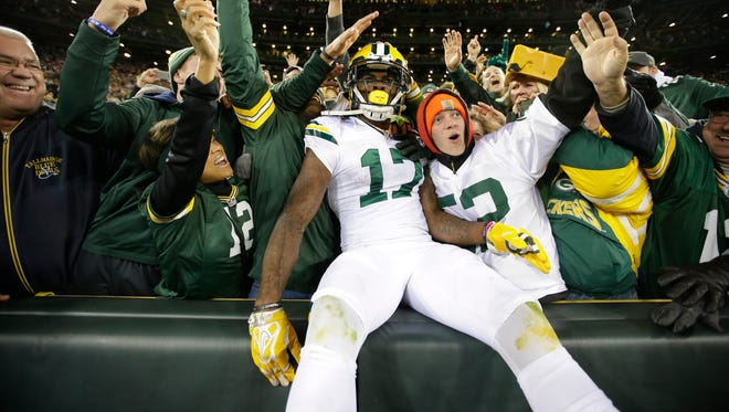 Green Bay Packers wide receiver Davante Adams (17) celebrates scoring a touchdown in the fourth quarter against the Chicago Bears at Lambeau Field.