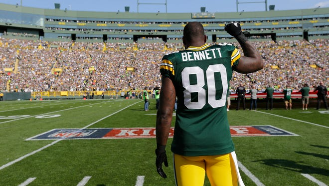 Green Bay Packers tight end Martellus Bennett raises his first during the national anthem Sunday, Sept. 10, 2017, at Lambeau Field