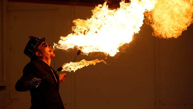 Josh Peters of St. Paul, Minnesota blows fire during the Dangerous Fun Show at Windigo Fest Saturday, Oct. 7, 2017, in Manitowoc, Wis. Josh Clark/USA TODAY NETWORK-Wisconsin