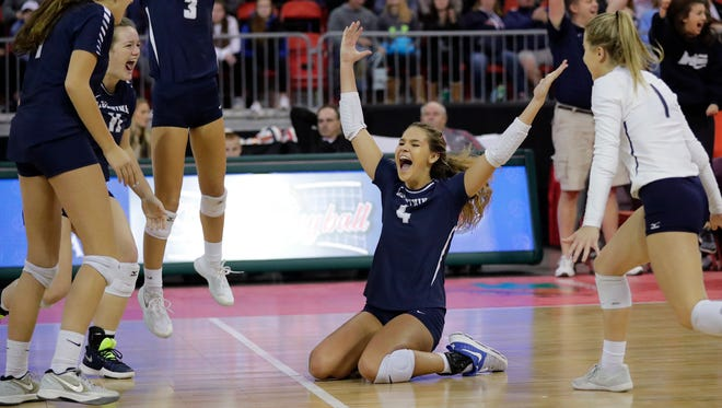 Lake Country Lutheran's Brooke Andersen (4) drops to her knees in celebration after the Lightning won match point against Regis in the Division 3 championship match at the WIAA State Girls Volleyball Tournament at the Resch Center on Saturday, November 4, 2017 in Ashwaubenon, Wis. Lake Country won the championship, 3-1.Adam Wesley/USA TODAY NETWORK-Wisconsin