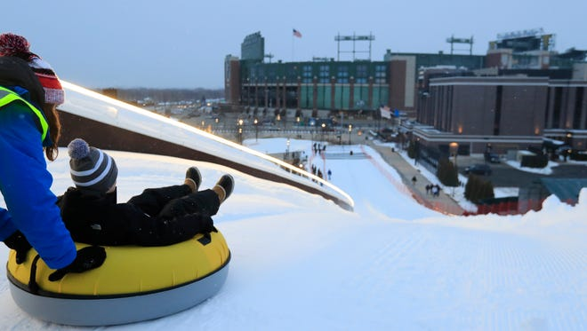 Tubers get a push on Ariens Hill in the Titletown District.