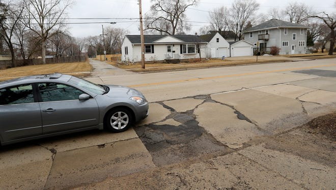Vehicles drive along Webster Ave  in Green Bay. A two-year project to convert the street north of University Avenue into a boulevard, at a cost of up to $15 million, begins in spring.