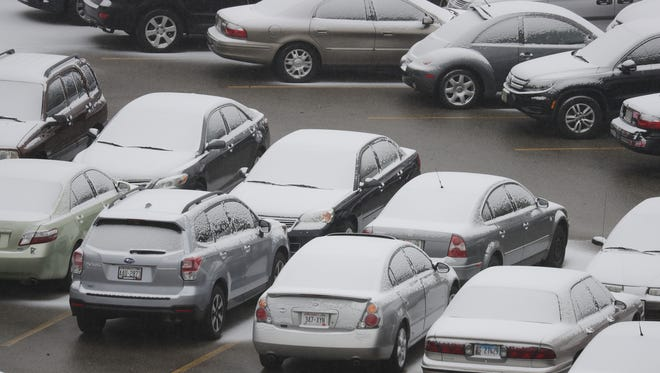 Snow begins to cover parked cars in the lot of the Banta Bowl at Lawrence University on Tuesday morning. Dan Powers/USA TODAY NETWORK-Wisconsin