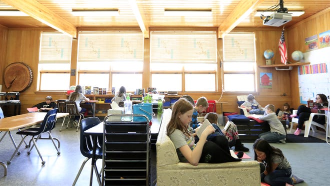 Fifth and sixth-grade students read during class at Goodman-Armstrong Creek Elementary School in Goodman.