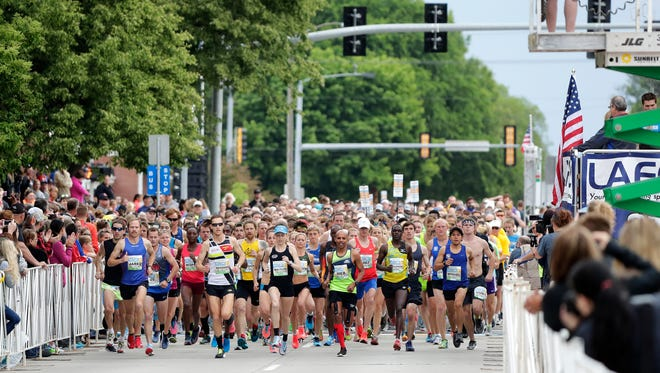 Runners take off at the start of the 2018 Bellin Run 10K on Saturday, June 9, 2018, in Green Bay.