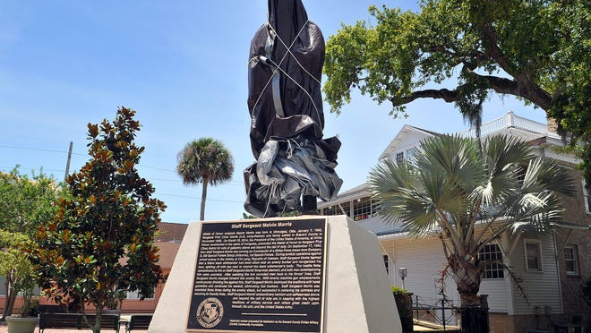 A covered-up statue of S/Sgt. Melvin Morris, a Medal of Honor recipient, will be unveiled Thursday evening in Riverfront Park in Cocoa.