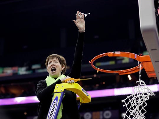 Notre Dame head coach Muffet McGraw celebrates by cutting down the net after defeating Mississippi State in the final of the women's NCAA Final Four college basketball tournament, Sunday, April 1, 2018, in Columbus, Ohio. Notre Dame won 61-58. (AP Photo/Tony Dejak)
