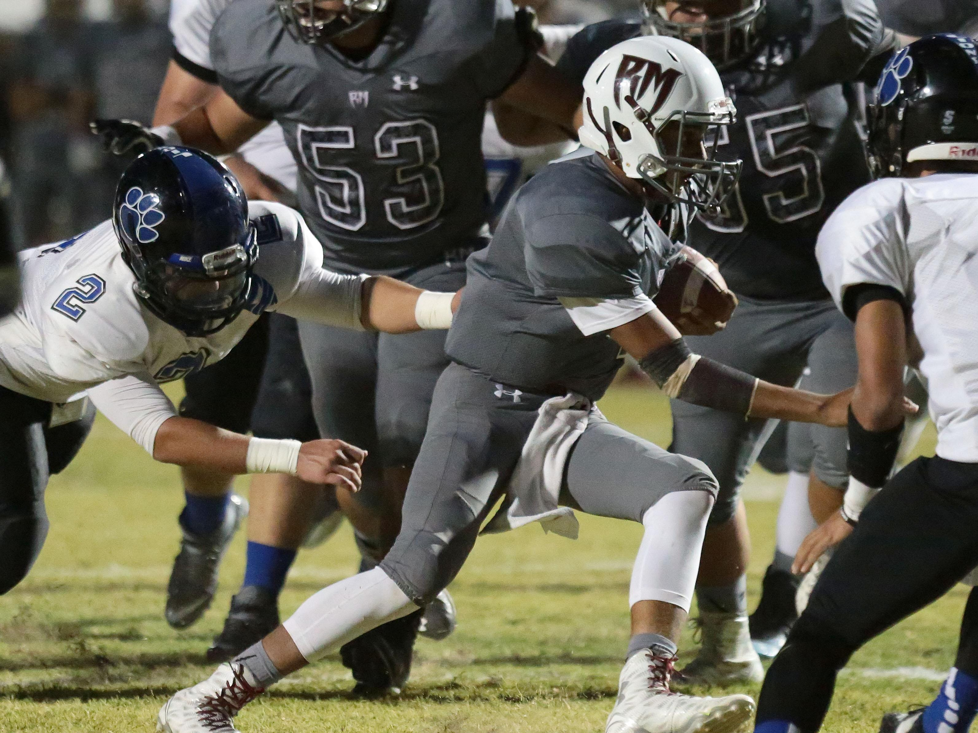 Rancho Mirage quarterback Marques Prior carries the ball for a first down in the first against Cathedral City of Friday.