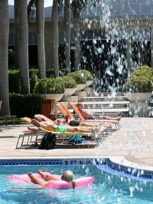 Guests relax and play poolside at Hyatt Regency Coconut Point  Resort & Spa in Bonita Springs on Thursday.