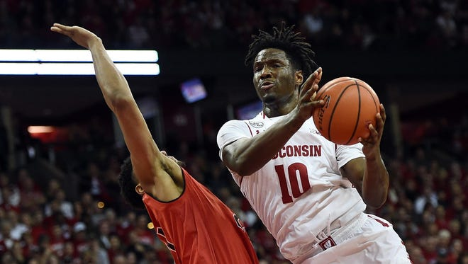 Wisconsin forward Nigel Hayes works against Maryland's Justin Jackson during the Badgers' win on Sunday at the Kohl Center.