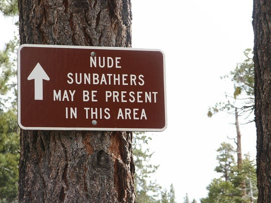 A sign south of the parking area at Chimney Beach alerts beach-goers to the possibilities.