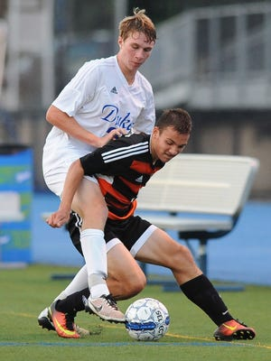 The play of Nathan Miller (right) is one reason Cedarburg is highly regarded this season.