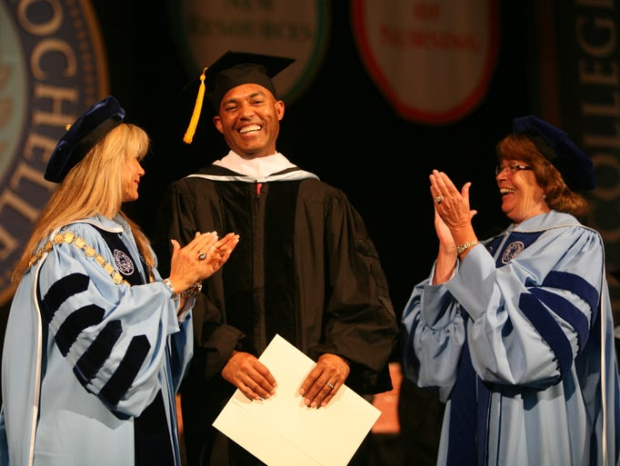 Mariano Rivera, Westchester resident and retired New York Yankee pitcher, is conferred an honorary degree by school president Judith Huntington, left, and Elizabeth Bell Levaca, the Chair of the Board of Trustees, during the 107th commencement for The College of New Rochelle, at Radio City Music Hall in New York, May 28, 2014.