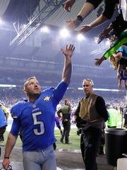 Lions kicker Matt Prater greets fans as he walks off the field following his winning 40-yard kick as time expired to top the Minnesota Vikings, 16-13, Thursday, Nov. 24, 2016 in Detroit at Ford Field.