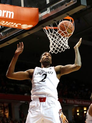 Cincinnati Bearcats forward Octavius Ellis (2) looks to grab the loose ball against the Tulane Green Wave during the first half at Fifth Third Arena.