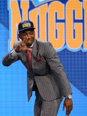 Jun 22, 2017; Brooklyn, NY, USA; Donovan Mitchell (Louisville) gestures on stage as he is introduced as the number thirteen overall pick to the Denver Nuggets in the first round of the 2017 NBA Draft at Barclays Center.