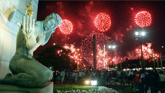 The fireworks in downtown Detroit in June 1994 with the Spirit of Detroit statue.