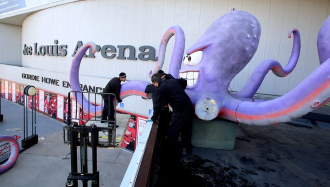 "Olympia Entertainment workers assemble one of the tentacles onto ""Al the Octopus"" on the roof near the Gordie Howe Entrance of Joe Louis Arena on Thursday, April 14, 2016."