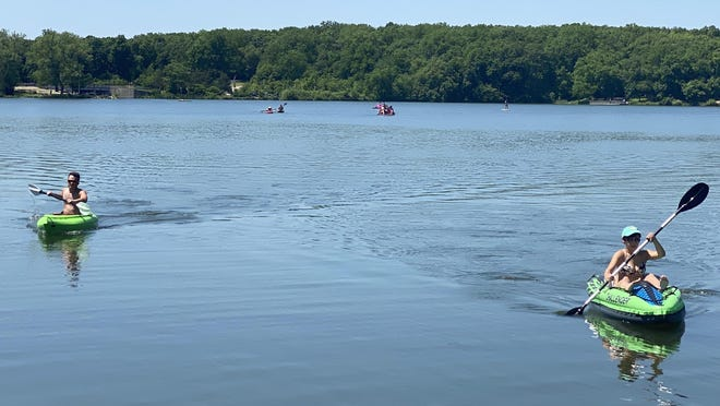 Kayakers paddle Tuesday on Pierce Lake in Rock Cut State Park.
